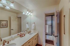 Guest bath with double sinks.