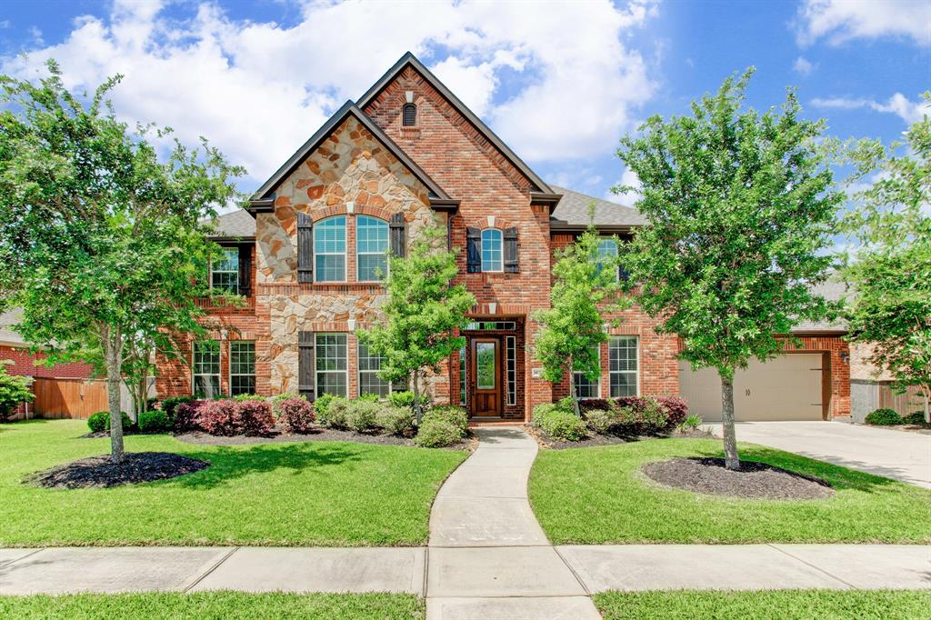 Gorgeous home across the street from the 15th hole fairway with high ceilings, superb natural light from an abundance of windows. At 7,002 sf, this home is one of the largest and was customized for the buyer with two bedrooms/baths down including master. Hardwoods down, carpet up.  Additional flex room off kitchen that could be used as a wine room, nursery, study, playroom, craft room, pet quarters... Wonderful large yard with new play set to be included with sale. Large covered patio. 3-car garage. Professionally cleaned, ready for move in.
