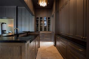 Wet Bar: Glass front inset cabinets with antique mirror backing