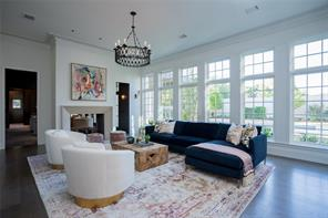 Family Room:  Random width wide plank white oak floors, crown molding, recessed lighting, art lighting, antique iron chandelier, 4 wood and iron antique sconces, floor outlets, expansive windows with views to the rear garden