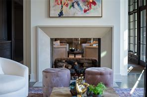 Family Room: 2-sided gas log fireplace with limestone mantel