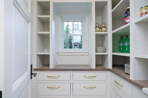 Pantry: Versailles pattern Sandstone floors, recessed lighting, white oak counter, unlacquered brass hardware adjustable shelves, tray storage
