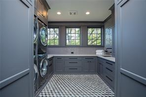 Laundry room : Quartz mosaic floor, recessed lighting, Opus white quartzite  counter, hand painted subway tile backsplash, matt black hardware, stainless steel sink with Waterstone matt black faucet, hobby counter, gift wrapping drawer