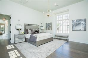 Master bedroom:  Random width wide plank white oak floors, 14' tall ceiling, Italian Murano glass chandelier, wired for sconces, masonry fireplace with gas logs and honed Calacutta surround, wired for sound and television, views to rear garden