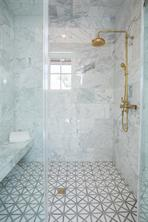 Master Bathroom: 2 walk-in showers with Calcutta marble walls, exposed Watermark Thermostatic Shower Systems