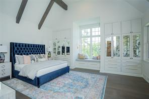 Bedroom 5 (north-west):  Random width wide plank white oak floors, crown molding, recessed lighting, vaulted clear pine beamed ceiling, built-in drawers and mirror front cabinets, and window seating with underneath storage.