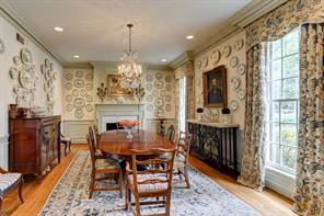 The formal dining room with windows facing the front of the house.
