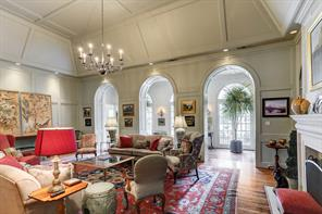 The living room with ceilings to 16 feet with arched cased openings to the gallery overlooking the back yard