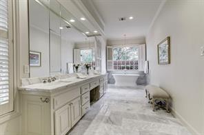 Her recently updated bath with private water closet and a large walk in closet