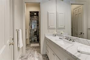 His bathroom ans walk in closet in the master bedroom suite.