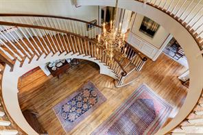 Looking down into the formal entry from the second level stair landing