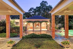 Immaculately maintained outdoors including the pavilion, summer kitchen, sheltered patio, and pool