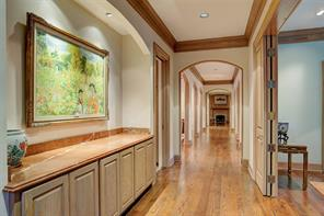 [Family room] The room includes a fireplace, a double door closet, and access to the outdoors