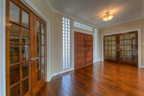 Entry showcases the Study on the left and the Formal Dining room on the right here.