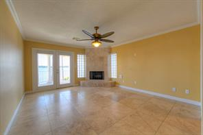 The Owner's Suite is home to the 2nd gas fireplace! There is a private balcony to enjoy the lake at sunrise or sunset! Pretty Travertine flooring. Only carpet in the secondary bedrooms.