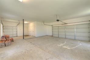 Huge over sized garage offers a large area for a golf cart with private door.