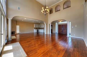 Clean lines are evident in this open, flowing floor plan. Wood floors were installed in 2013.