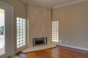 Gas log fireplace is dressed with floor to ceiling travertine!