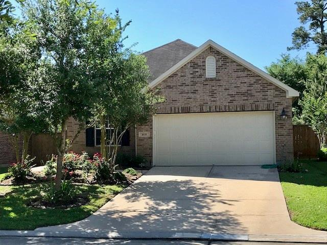Front of home with well maintained landscaping.