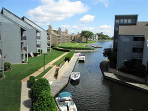 Great view of the lake canal with boat tie-ups for temporary use by residents!
