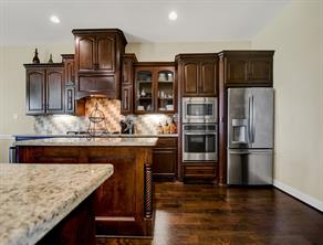 Stain grade kitchen featuring Stainless Appliances.