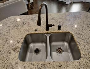 Kitchen faucet with undercount sink.