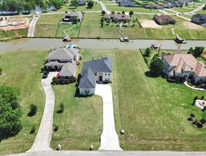 Aerial View of the home and the canal behind it.