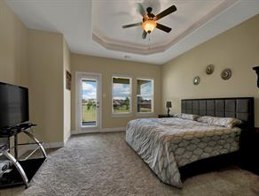 Upstairs Bedroom with popup ceiling and balcony.