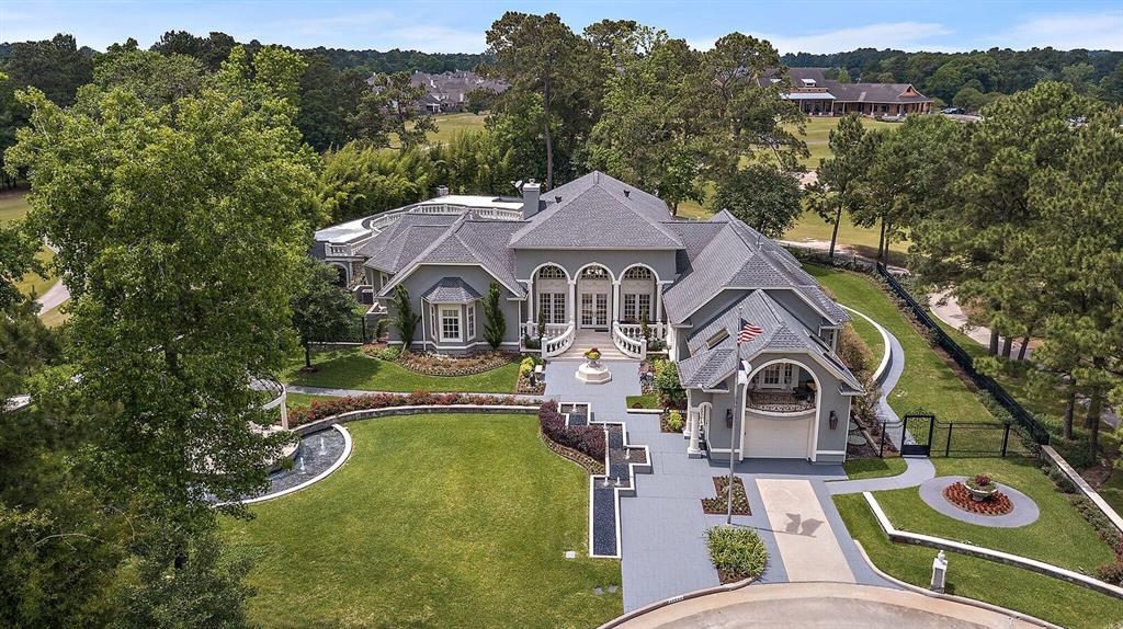 """""""Gem at Oakhurst of Kingwood""""- Stunning luxury home built on 3 lots in private cul de sac w/300 degree golf course views! Fascinating history-designed & functioned as a European embassy. This Italian-Mediterranean style home has 3 master bedrm suites (3rd bedrm loft can be 4th bedrm). Elegant 900 sf ballroom w/8 ft crystal chandelier. Family rm has an 11 ft drop down screen, HD projector, surround sound, remote controlled electric blackout curtains & a stunning panoramic view of the golf course & pond. Outside: spectacular heated 25,000 gallon pool/hot tub, 1700 sf lanai w/outdoor kitchen, fireplace, roof top terrace overlooking the 18th green, two climate controlled bathrooms & workshop. There is also a 3,000 sf climate controlled basement capable of parking 8 vehicles & contains a kitchenette, second laundry, safe room (walk-in vault), bathroom & elevator. Windows are protected w/Lexan to prevent damage from storms or golf balls. Sophisticated camera/DVR security system w/monitors."""