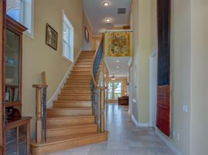 High ceilings and this gracious foyer welcomes your guests