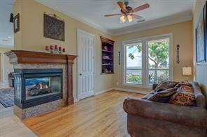 This lovely 3-sided gas log fireplace and open water views are enjoyed by your living areas & the Kitchen