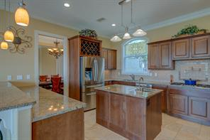 The cook will appreciate this kitchen's gas cooktop w/ pot filler, 2nd sink, wine storage, granite countertops, back splash laid on the diagonal and stainless steel appliances