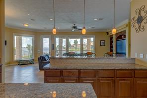 Prepare meals while enjoying an incredible view of Lake Conroe
