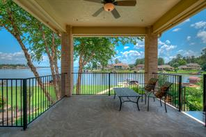 Large covered 2nd story patio affords panoramic views of Lake Conroe