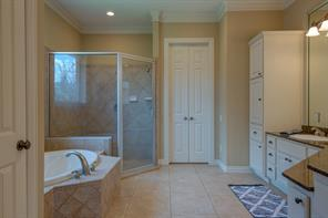 This large Master Bath boasts granite countertops, an oversized shower and lovely garden tub. Along with plenty of storage space