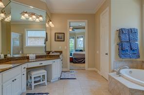 With 2 sinks and a separate vanity, you're never lacking space in this huge Master Bath