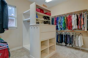 HUGE walk-in closet has a great combination of hanging + drawer + shelf space