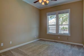This bedroom has an awesome overview of Lake Conroe!