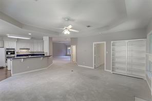 Your Family Room has built ins along with a gas logged fireplace.