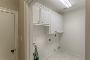 Your Laundry Room is located directly off the two car garage.  Notice the extra built in storage.