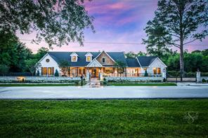 This completely redone country charmer is like a page out of Veranda magazine. It is the perfect example of the farmhouse modern design done right.