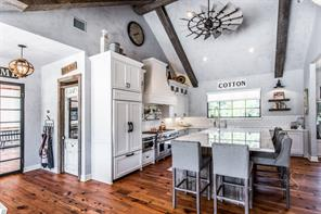 """No expense was sparred in creating this incredible kitchen, Venetian plaster wallsGather around the oversized Carrara marble island in this """"to die for"""" kitchen with Venetian plaster walls, wood floors, Wolf Epicurean gas range, built in cabinet style fridge, custom cabinetry and wood beam accented cathedral ceiling."""