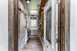 Even the farmhouse style pantry is amazing. The combination of pantry and laundry room works incredibly well together. Reclaimed door finishes the look.