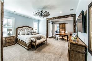 Luxurious master bedroom suite complete with your own wood framed study area, designer paint and lighting finishes and plush carpeting.