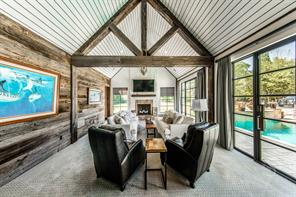 It just doesn't get better than this...Owners retreat with Cathedral raw wood beamed ceiling, reclaimed wood accent walls, custom window and doors, plush carpeting, designer drapery leading to the cozy fireplace sitting area overlooking the pool and back yard.-