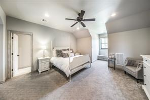 Spacious upstairs secondary bedroom is like a secondary master bedroom. Plush carpet and adjacent sitting area make this the perfect space.