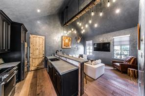 You won't be able to get your guests to leave this well designed space that is also perfect for an art studio or completely private home office.