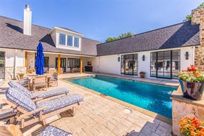 Unwind and recharge in this sparkling pool and outdoor lounge area.