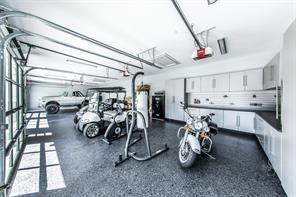 Showcase your vehicles and motorized toys in this attractive garage space that is finished out to the max.