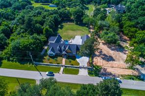 Aerial view of this distinctive Katy, TX property. The adjacent lot is owned by the seller and can be purchased with this home.  It would be the perfect spot for a barn and stables or whatever your heart desires.